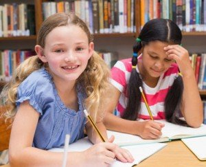 photodune-10572049-cute-pupils-drawing-in-library-at-the-elementary-school-xs