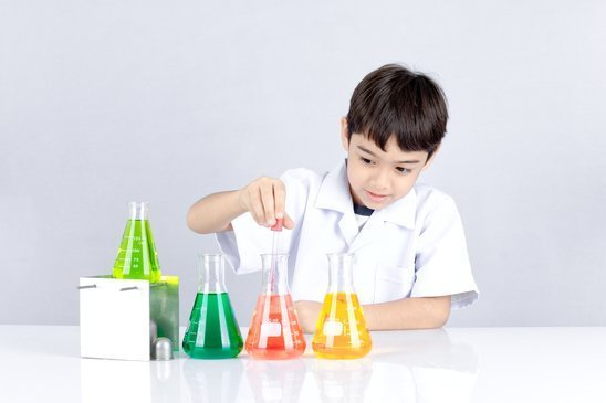 Easy Science experiment for kid, the boy has fun when he test acid or color liquid in beaker for education about chemical.