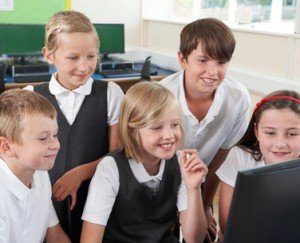 photodune-9860190-group-of-elementary-school-pupils-in-computer-class-xs